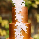 copper wedding cake with trailing leaves detail