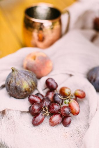 pink fabric with fig apricot and grapes