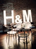 cool urban chic table setting with retro chairs and lit up initials