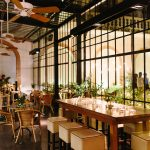 urban cool wedding setting with huge industrial style windows and a mixture of seating options