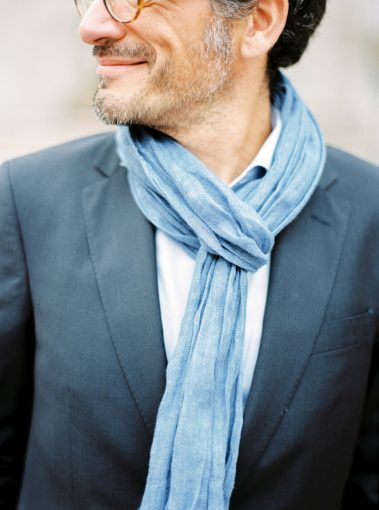 groom wearing a navy suit white shirt and accessorised with a pale blue scarf