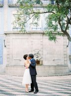 bride and groom dance and kiss in the city surrounded by traditional architecture