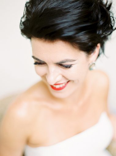bride with a classic updo and chic red lipstick