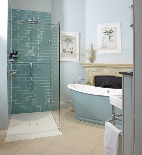 luxe bathroom at clevedon hall hotel with turqouise colour scheme and roll top bath