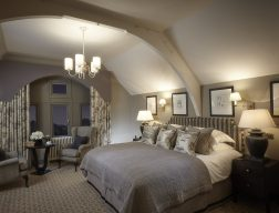 luxe hotel room at clevedon hall with grey and stone colour palette and decadent light fittings