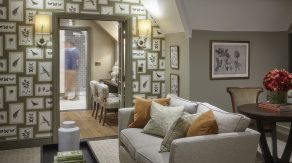 luxe hotel room at clevedon hall with modern sofa and feature wallpaper