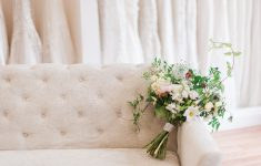 beautiful bouquet displayed on a cream linen sofa
