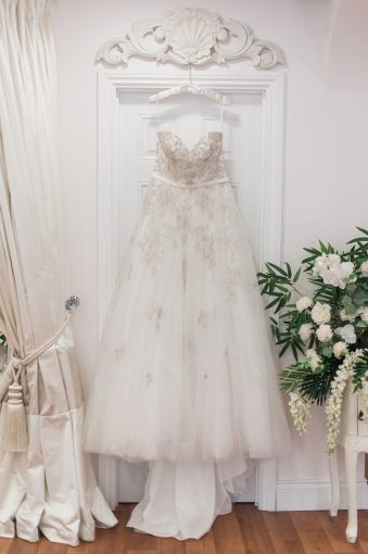 embellished wedding dress hung in the boutique