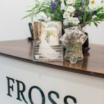 the Fross wedding boutique desk with a display of flowers