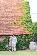 couple stand by a beautiful old building at Stanlake
