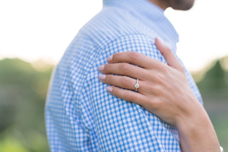 maddy's hand on chris' shoulder displaying her exquisite engagement ring