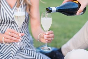 couple pouring champagne into glasses
