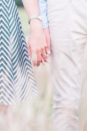 couple holding hands and her beautiful engagement ring