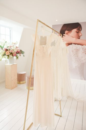 golden modern fashion rail with whistles wedding dresses