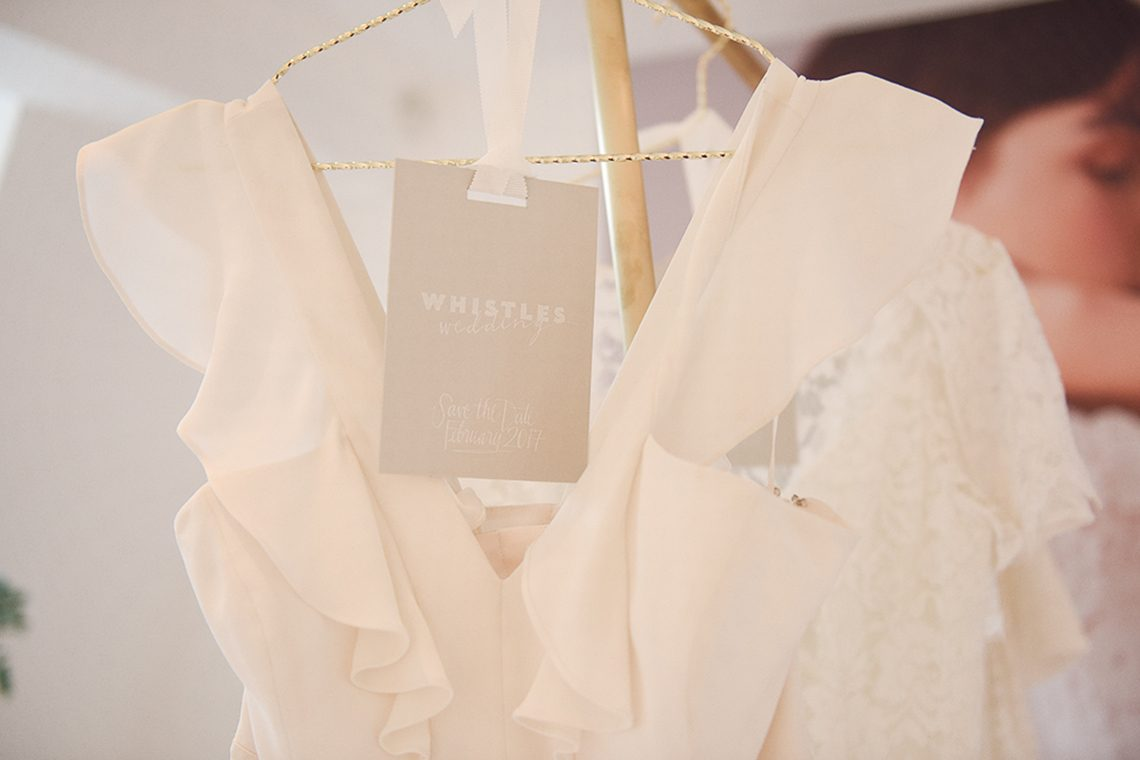 ruffled silk neckline wedding dress by Whistles bridal collection