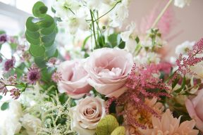 display of flowers with pink roses