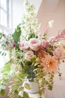 amazing arrangement of flowers with pink roses peach dahlia and eucalyptus