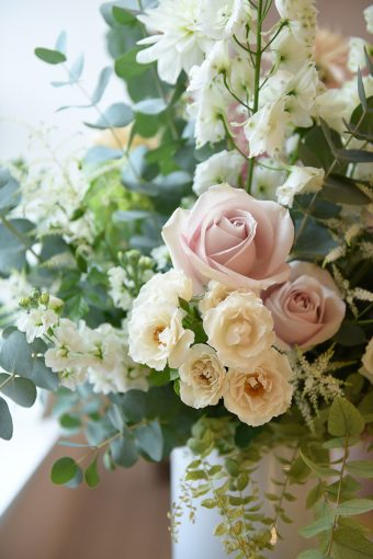 beautiful floral arrangement with pink and cream roses and eucalyptus
