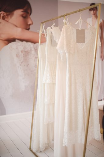 stylish gold fashion rail with the whistles wedding dresses displayed