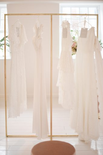modern gold fashion rail displaying the whistles wedding dress collection
