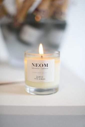 neom candle lit and glowing at the whistles ss17 wedding press event