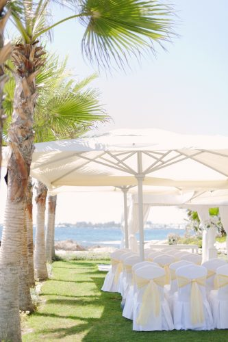 ceremony space outdoors under a canopy of parasols