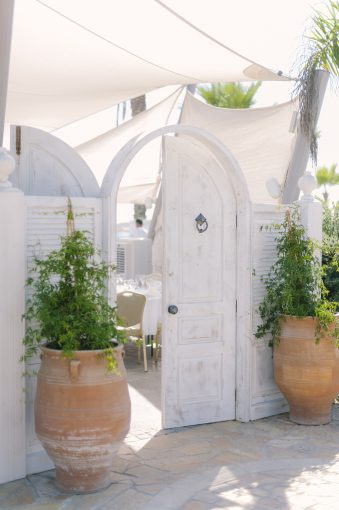 white washed doors leading to a restaurant at Olympic lagoon resort hotel