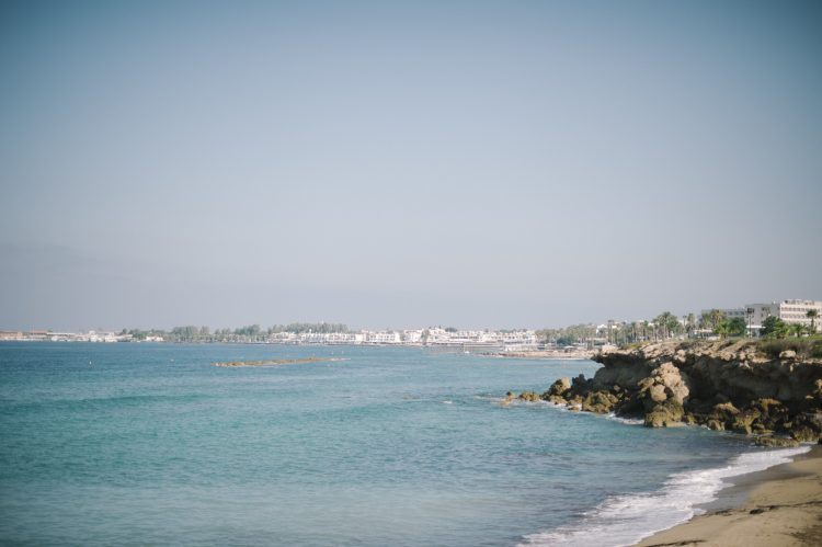 the sea and coastline by the Olympic lagoon resort hotel