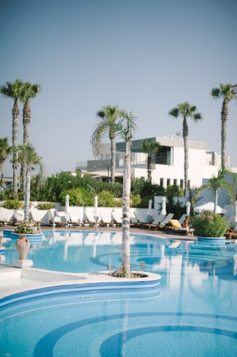beautiful pool area and palm trees of the Olympic lagoon resort hotel