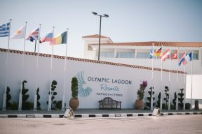 the front feature signage of the Olympic lagoon resort hotel