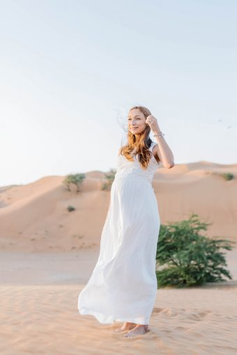 maternity portrait with a sand backdrop dunes and tree