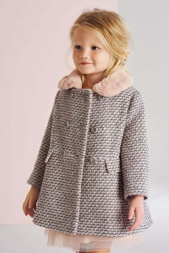 little girl wearing a pink and grey tweed coat with a little pink faux fur collar