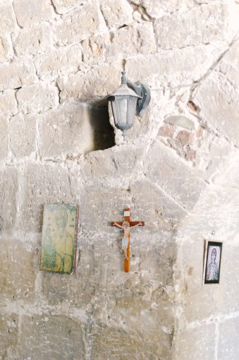 inside the church and art hung on the walls