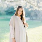 maternity session portrait with loose curls and cardigan with white shirt