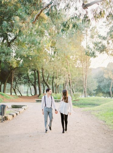 couple walking hand in hand in the park