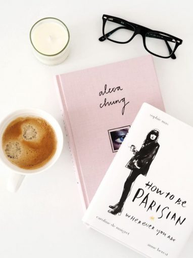 trendy books with a cup of coffee and spectacles
