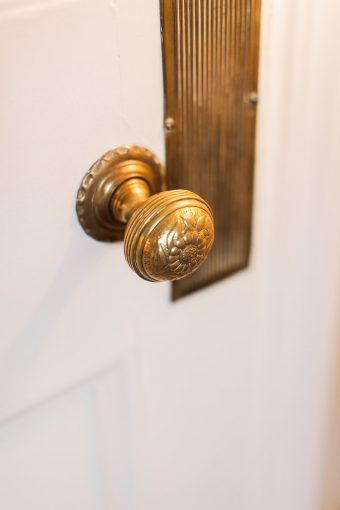 antique decorative door knob in gold