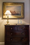 beautiful dresser with a fantastic traditional painting