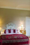 bedroom in the hotel with an ornate white bed