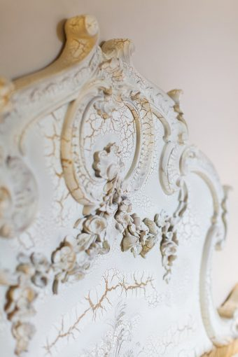 detailing of the beautiful ornate headboard