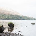 loch edge with moss covered boulders