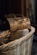 wicker basket filled with logs for the fire