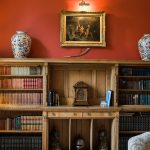 antique bookcase filled with beautiful old books