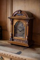 antique wooden clock with carvings