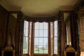 elaborate bay window with traditional tapestry style curtains