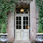 beautiful doorway of the hotel surrounded by ivy