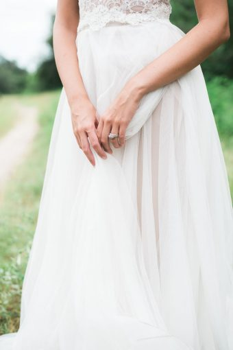 bridesmaids skirt of her dress and hands displaying a ring