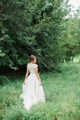 bridesmaid walking through the grass