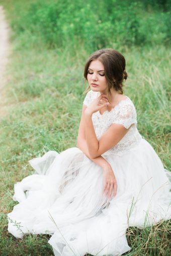 bridesmaids portrait sitting with the tulle skirt of her dress fallen in a circle around her