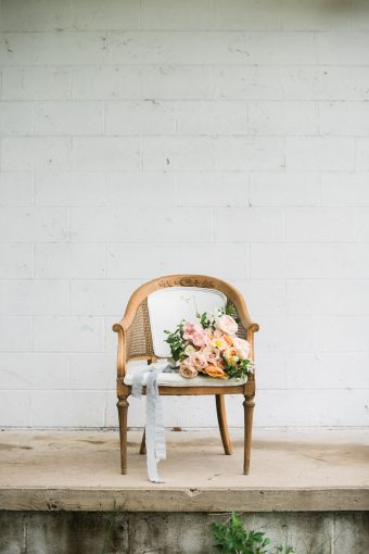 fine art style bouquet with beautiful silk ribbon trailing displayed on a chair
